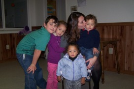 A mom and her four children enjoy a family hug at St. Martin's House